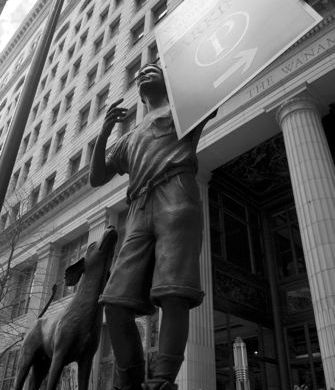Heard on the Street: Statue directs traffic to parking for the Wanamaker Building, Philadelphia.