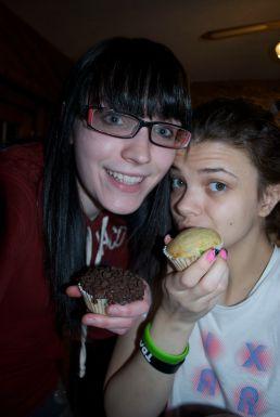 Enjoying Pilsbury Funfetti cupcakes, one iced, one not.