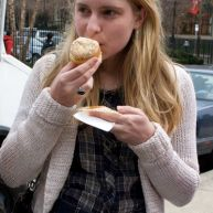 A Temple University student enjoys a vanilla buttercream cupcake from Buttercream, the Cupcake Lady, Philadelphia.