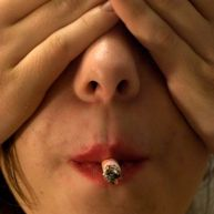 A shot for an ad against smoking, implying kissing a smoker is essentially like kissing the butt of a cigarette.