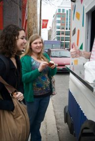 Two happy girls at the Cupcake Truck.