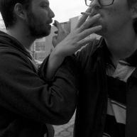 Two guys participate in an endearing smoke break outside Annenburg Hall, Temple University.