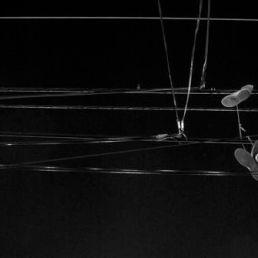 Sneakers on telephone wire on N.16th & Berks Streets, Philadelphia.