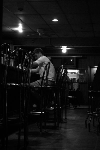 A lone man sits in one of the many bars in Manayunk, PA.