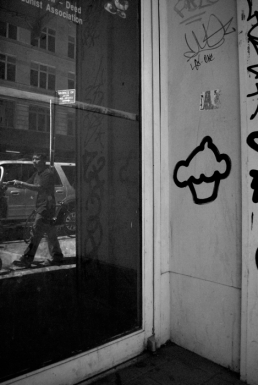 A cupcake tag on the doorway of an abandoned shop.