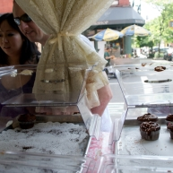 Passersby gaze into the windows of Magnolia Bakery on Bleecker Street in downtown Manhattan.