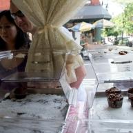 Passersby gaze into the windows of Magnolia Bakery on Bleecker Street in downtown Manhattan.