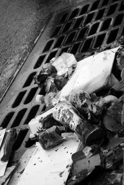 Burnt garbage and plastic now litter the gutter of this street. Which was more harmful to the environment? New Yorkers may experience instant ramifications. We may not live long enough to know.
