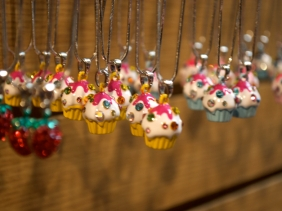 Bejeweled cupcake necklaces at a vendor in Chinatown, New York City.