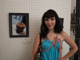 "Betty Breznay stands next to ""Peanut Butter Cupcake"" at the Fine Arts Fiesta, Wilkes Barre, PA. 2010."