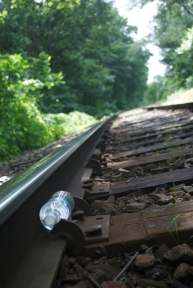 A full plastic bottle of water sits in the train tracks of Hanover Township, just waiting to get crushed and splattered.