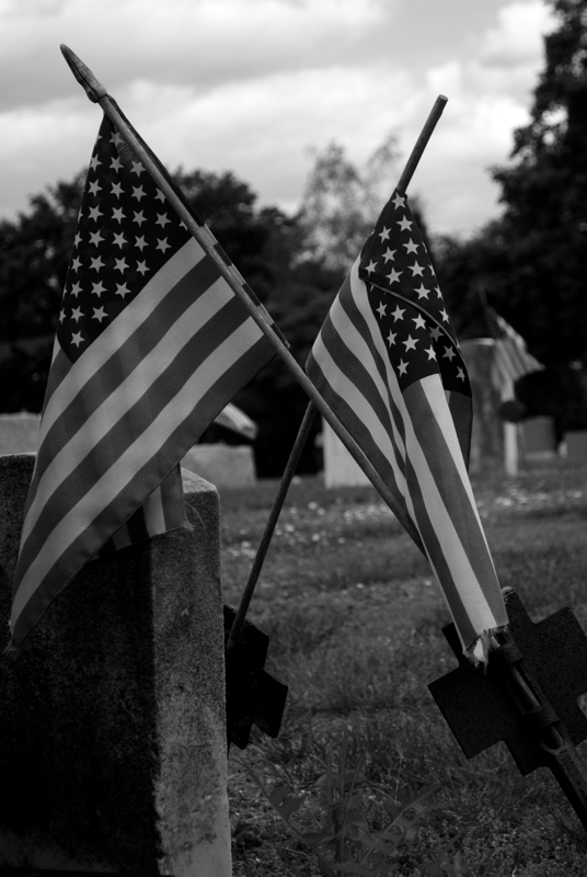 Even the American flag of the deceased veterans fail to stand up straight in this mostly neglected environment.