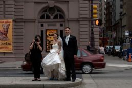 A photographer photographs me photographing her and her wedding couple on South Broad Street, Philadelphia.