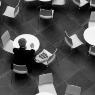 A lone man sits in the dining court of the Kimmel Center.