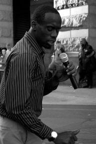 A man sings covers of popular R&B songs on East Market Street, Philadelphia.