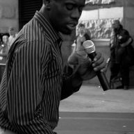 A man sings covers of popular R&B songs on East Market Street, Philadelphia.