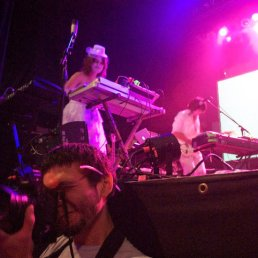Walbert Young photographs the crowd at Of Montreal from the barricade.