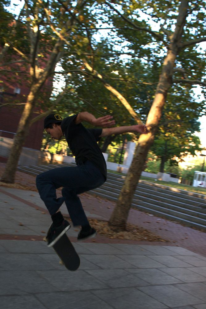 """Isaac Jaeggi, 19, from Silver Spring, Maryland, winds down a busy Labor Day of travel with some skating at the popular skate spot on Temple University's campus. Isaac says he likes skating here, """"It's tight."""""""
