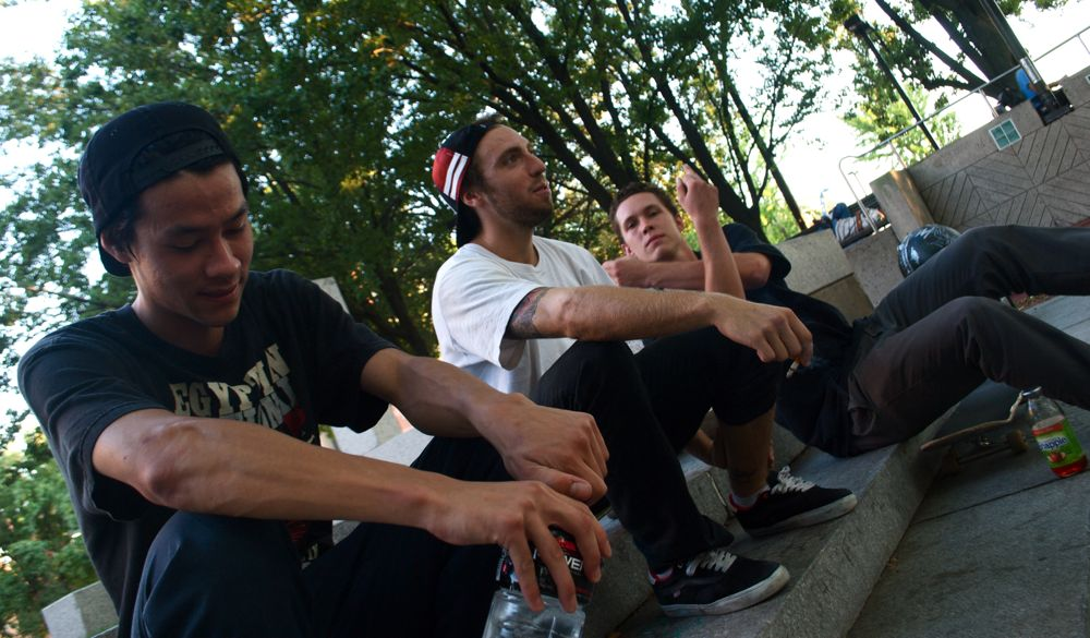 """From left: Isaac Jaeggi, 19, Colin Keaton, 19, and Brian Leddy, 21 take a break from skating at the corner of Cecil B. Moore Avenue and Broad Street on Monday, September 6, 2010. """"I met these guys here,"""" Leddy says."""
