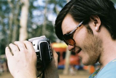 Kyle Psulkowski shoots with a Canon. It's ok, I still think he's cute.