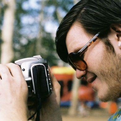 Kyle Psulkowski shoots with a Canon. It's ok, I still think he's cute.