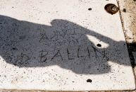 "Someone has carved ""Ballin"" on a sidewalk on Spring Garden Street. Kyle Psulkowski, a renowned baller himself, shadows it."