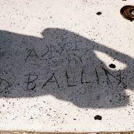 "Someone has carved ""Ballin"" on a sidewalk on Spring Garden Street. Kyle Psulkowski, a renowned baller himself, shadows it."