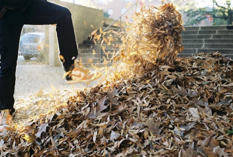 Kyle Psulkowski kicking leaves.