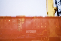 1300 as seen through the orange construction fence on Broad Street.