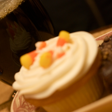 A Halloween inspired vanilla cupcake reflects in Olivier Greco's iced coffee.