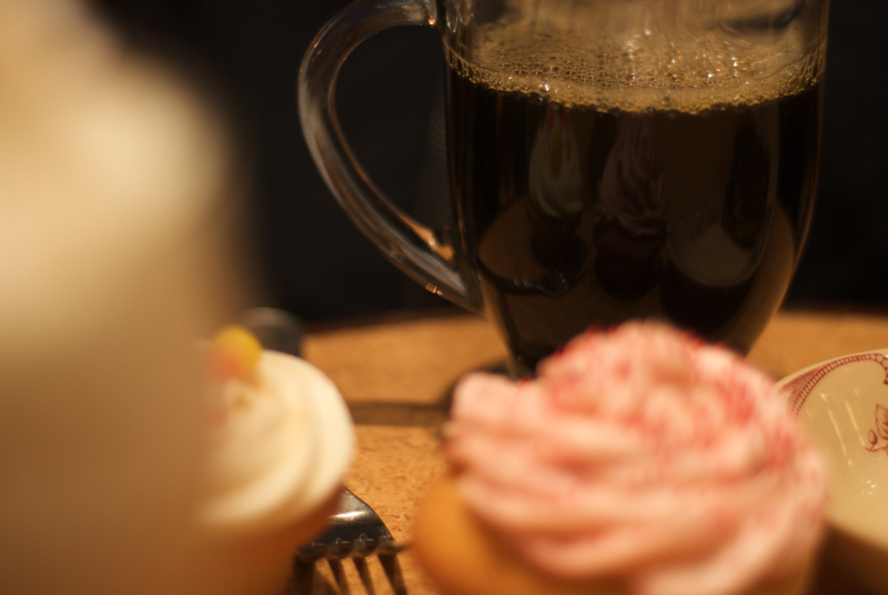 The reflections of Naked Chocolate cupcakes in an iced coffee.