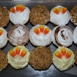 Betty Crocker funfetti cupcakes with crushed cookies on some, Nutella on others, and candy corn on the rest.