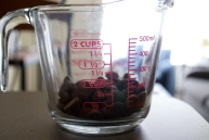 Ghirardelli milk chocolate chips in a measuring cup for the sake of making it look like I actually made cookies without a package - but we really added these extra chips!