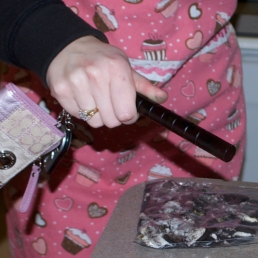 """Beating Oreo cookies to crumbs with Ally's """"Krav Maga Stick"""" that she keeps on her keychain for self defense."""