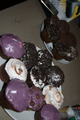 The finished cupcakes! Swamp Things covered in Oreos and sprinkles, ugly purple, and Nutella!