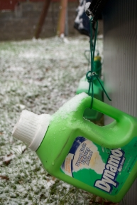 The jugs full of water that weigh down the pull cover are now weighed down by snow.