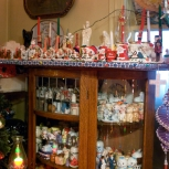 A non-Christmas salt and pepper shaker cabinet stands year long.