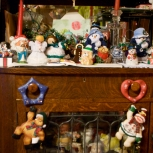 Other trinkets are behind glass, subordinate to the Christmas decor.