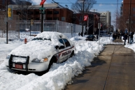 What a great time to commit crime on Temple's campus! (There were several cop cars still covered in snow by noon.)