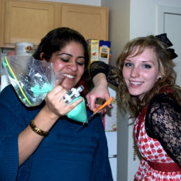 Sunia Mian guides Betty in creating a homemade pastry icing bag.