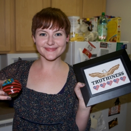 Brittany, her Truthiness plaque, and her Merican cupcake!