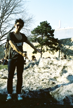 Sam Han indicates the scale of this massive snow pile still present in the 60 degree weather.