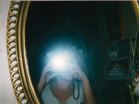 A self portrait with my first camera ever. 9 years old. Note the lack of collar bone.