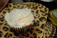 """Believe it or not, this cupcake says """"xox,"""" clear on white."""