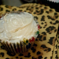 "Believe it or not, this cupcake says ""xox,"" clear on white."