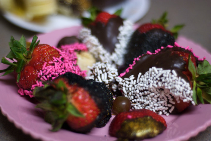 Chocolate-, Sprinkle-, and Black Glitter-covered Strawberries.