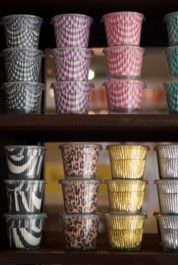 Several of the hard to find cupcake wrappers I've traveled from the Italian Market to New York for, now at my finger tips.