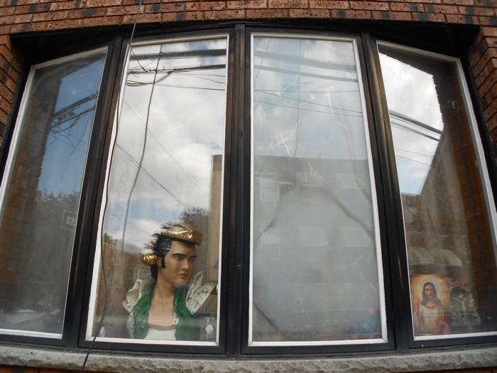 Elvis in one window and Jesus in another.