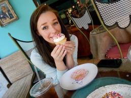Inga smiles behind her generously iced PhillyFetti.