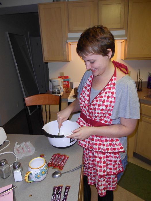 Brittany diligently mixes the ingredients, following the slightly incorrect recipe.